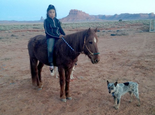 Navajo girl on horse